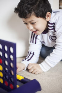 Boy playing Connect Four game