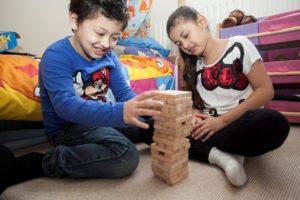 Brother and sister playing Jenga