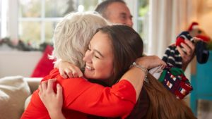 Care leaver hugging support worker at Christmas