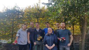 Corporate gardeners volunteering at semi-independent home